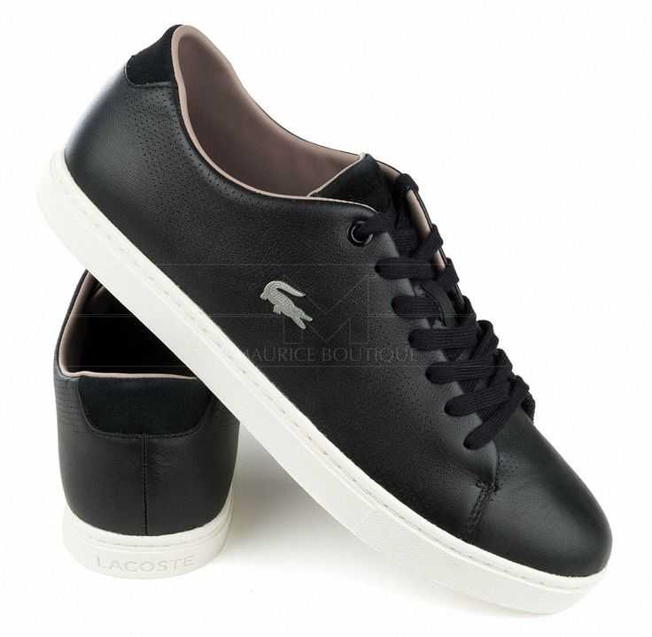 Zapatillas Lacoste de color negro Zapatillas Lacoste de cuero  Zapatos Lacoste con parches decorativos de ante en talonera y lengüeta Zapatillas Lacoste de punta redonda·