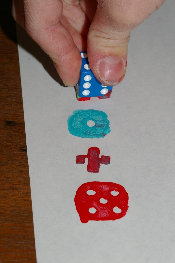 dice stamping = fantastic. a fun way to make math sentences!