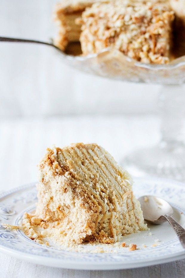Russian Honey Cake - classic traditional cake. Thin honey leyers frosted with sweet dense custard. Sprinkled with crust dust. Check it now or save for later