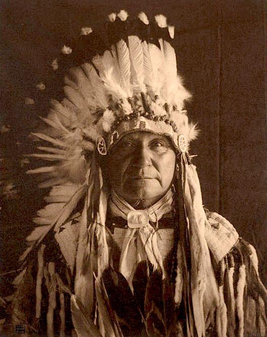 Chief White Spoon. Arapaho. ca. 1907-1912. Photo by Carl Moon. Source - Huntington Digital Library.