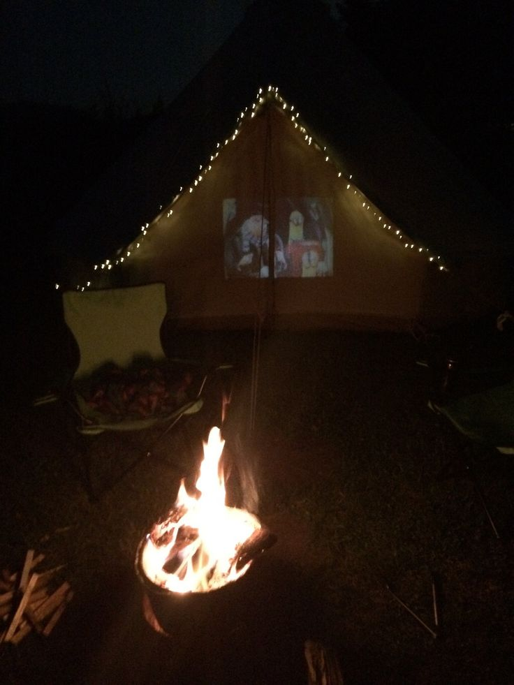 Bell tent glamping - kids in bed watching movie on projector, parents drinking vino by the fire. Bliss! #marietompson