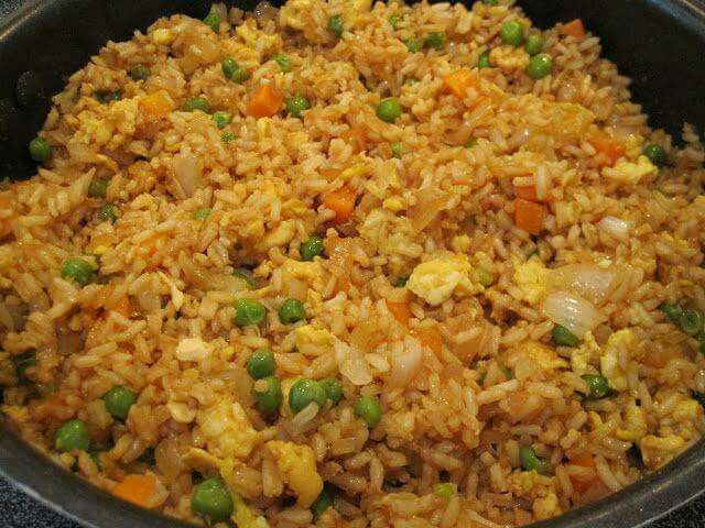 "My husband and kids LOVE fried rice! This recipe is to the ""T"" how we make it at home. You will never enjoy restaurant fried rice again, this is so fresh! FRIED RICE 3 cups cooked white rice 3 tbs sesame oil 1 cup frozen peas and carrots (thawed) 1 small onion, chopped 1tsp minced garlic 2 eggs, slightly beaten 1/4 cup soy sauce On medium high heat, heat the oil in a large skillet or wok. Add the peas carrots mix, onion and garlic. Stir fry until tender. Lower the heat to medium low and push…"