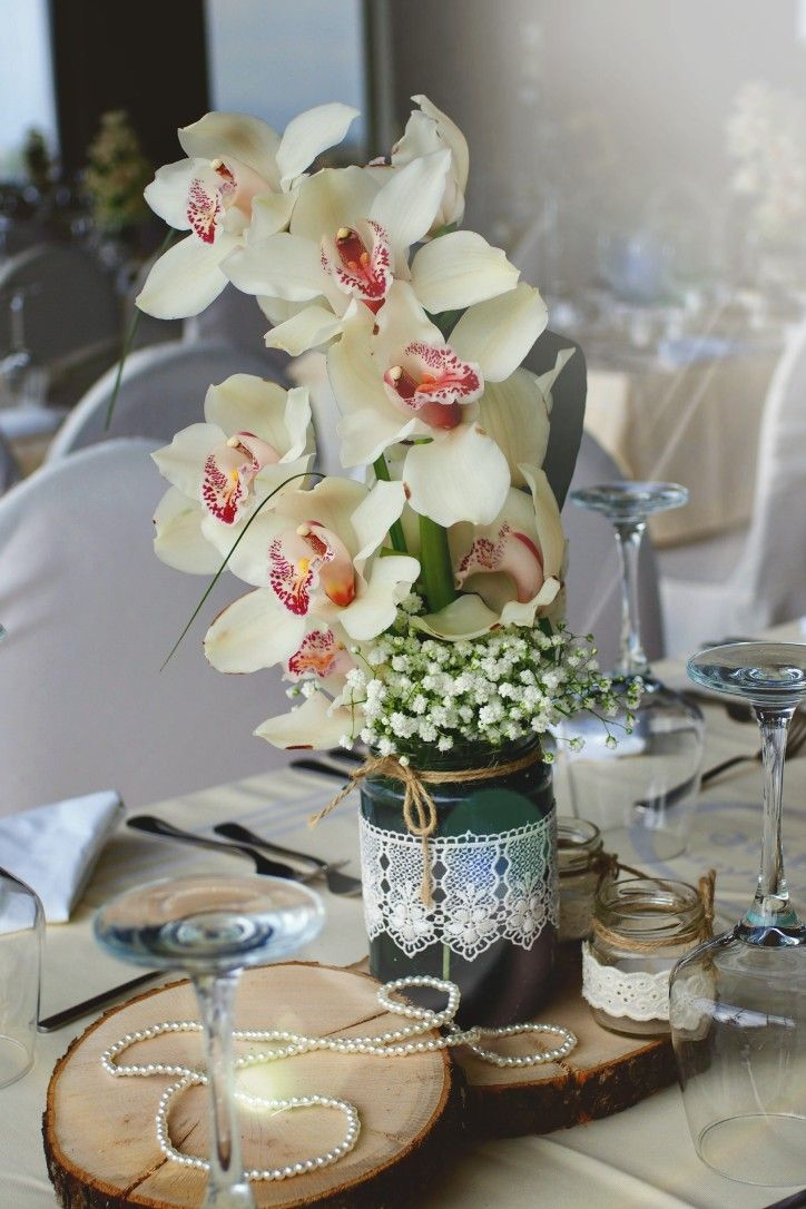 Orchids Wedding centre piece #weddingdecoration #charismadecoration #orchids #centrepiece