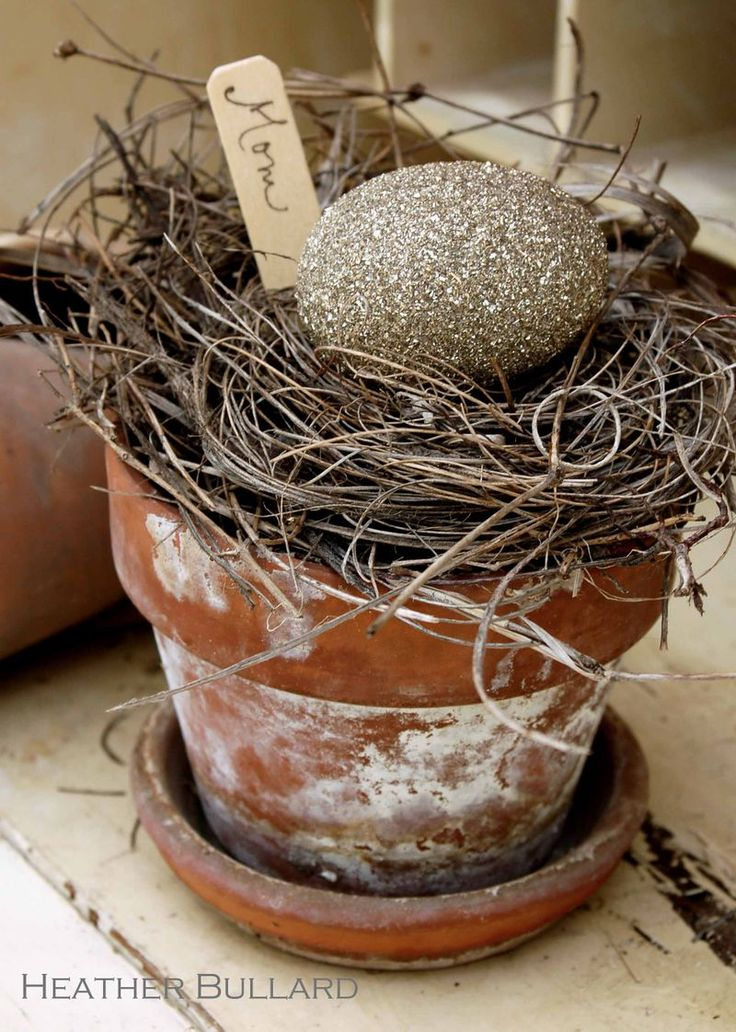 White-washed terracotta planter with Nest and stone egg. Can also be used as a place marker for dinner entertaining.