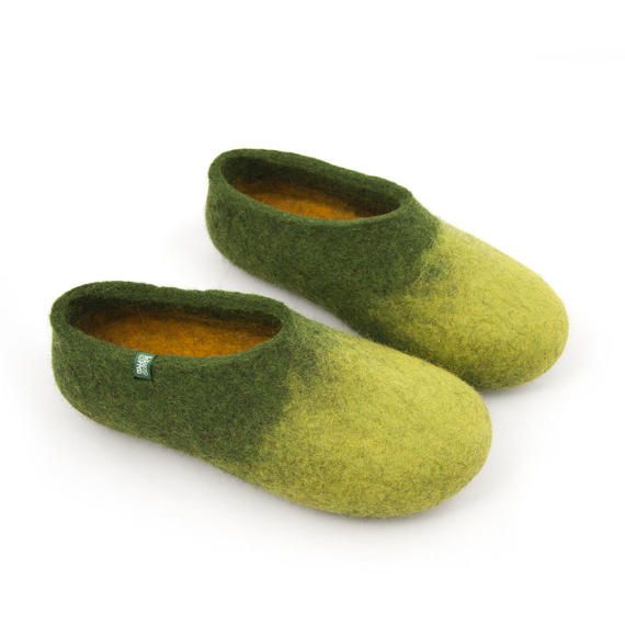 Felt slippers made in two shades of green sheep wool on the outside with yellow on the inside. These womens house shoes in ombre green will bring the freshness of spring inside your home. At Wooppers we make boiled wool slippers in environment conscious manner.