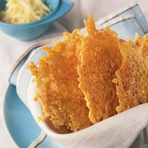 Montasio Cheese Crisps  Lidia Bastianich, who owns New York's Felidia and operates a restaurant called Frico with her son, grew up eating frico, the irresistible fried-cheese snack, in her hometown of Pula, Croatia (once part of Italy). Frico may be stuffed with a variety of fillings. When making this simple version, we added a little flour to help it hold its shape.
