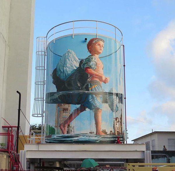 Enfant, La Terre se noie et tu ne peux la sauver en l'emportant sur ton dos ! / Hiighlighting climate change impact. / Street art. / Puerto Rico./ By Fintan Magee.