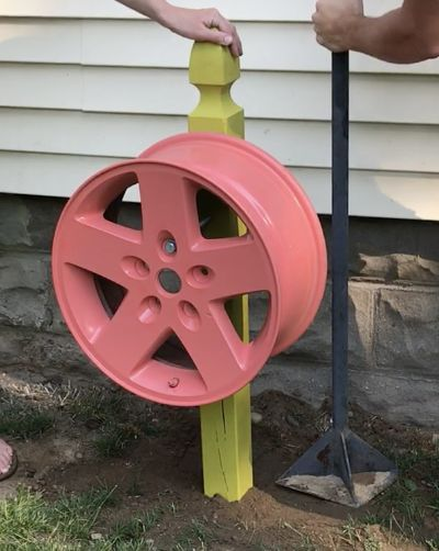 Tire Rim Water Hose Holder