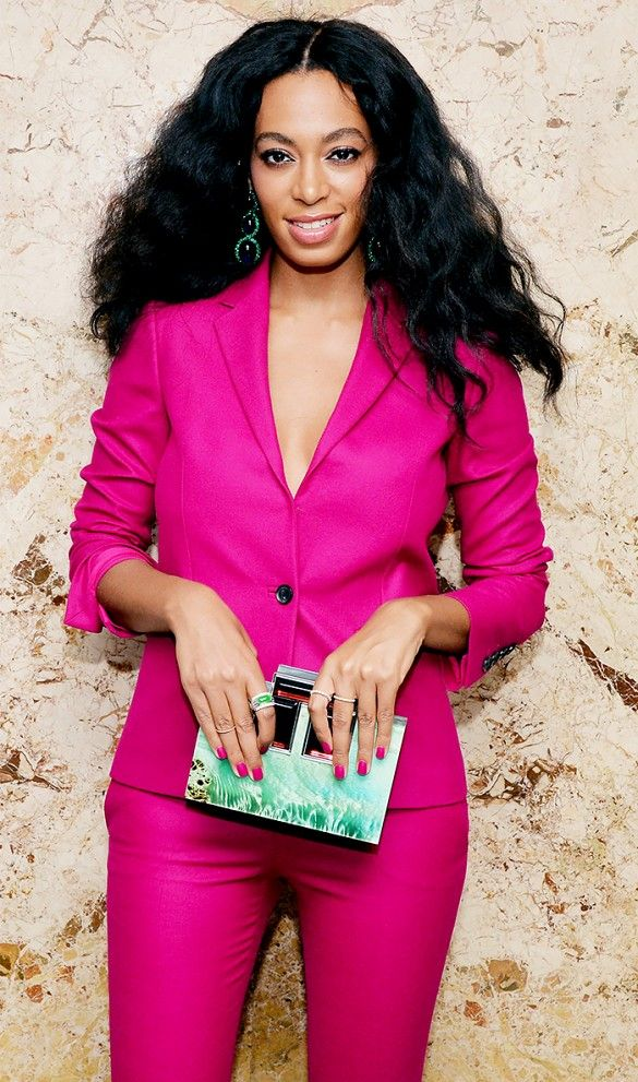 Solange Knowles rocks a menswear version of the plunge trend in a fuchsia Gucci suit // #celebritystyle
