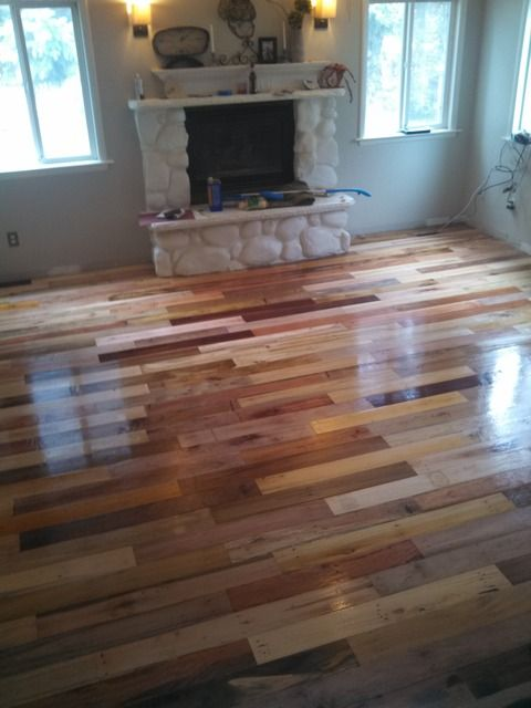 My wife an i wanted to install hardwood floors in our house but with a quote from a local flooring specialist of over $13,000 it was cost prohibitive.  After much searching I found a source willing to give us a supply of hardwood pallets used for importing coconut oil.  Many MANY hours of sawing the nails to disassemble, hammering the nails out, planing, cutting, installing and varnishing we have been left with what we feel is a characterful and beautiful floor that will hopefully last…