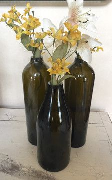Upcyled wine bottle vases. Beautiful wine bottles have been hand cut, hand sanded and hand polished to make these perfect and unique vases. Set of 3. Flowers not included.