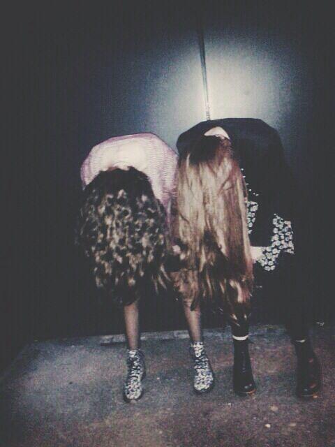 Stood in a dark room shaking our hair. Ann