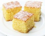 Fluffy, moist, cooling and extra syrupy! A mouthwatering traditional Greek dessert with the flavours and aromas of flaked coconut and oranges. This locally sourced recipe with step by step instructions will help you make the most syrupy, fluffy, tasty ravani cake ever!