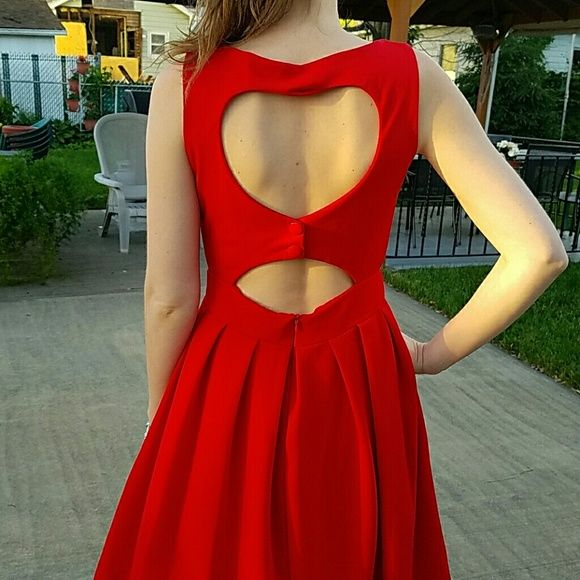 Heart back dress Most adorable red dress with a heart cutout and a small keyhole cutout on the back. It shows just a little skin but not too much! No tags but never worn Dresses