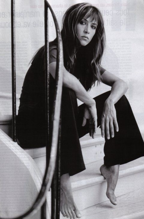 Sophie Marceau...love this photograph...a non-traditional pose, siting on stairs, barefoot...genius...great actress & model: notice intensity in her face! ❥-Mari Marxuach Parrilla
