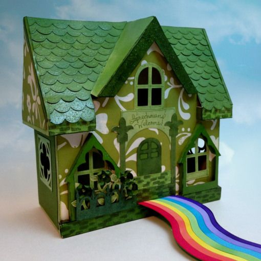 "Here's a really cute idea coming from Allie! She calls this her ""Shamrock Shanty""! That's a catchy name! This shanty is ready for St. Patrick's Day and is actually the Cottage from PEONY COTTAGE SVG KIT! Check out the rainbow path leading to the door, awesome idea!"