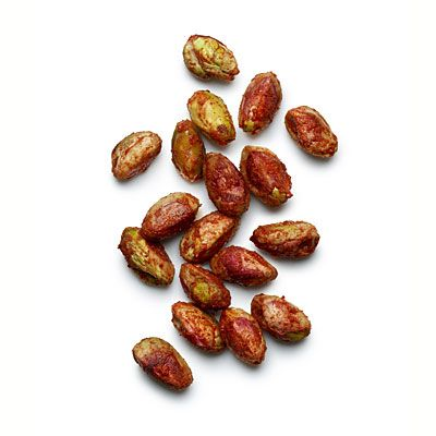 """Spiced pistachios  78 Calories    18 Pistachios roasted with 1/2 teaspoon paprika, 1/8 teaspoon cayenne pepper, and juice from 1/4 lime.    One of """"8 Finger Foods Under 80 Calories"""" on Health.com."""