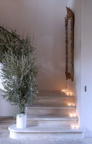 Simple branches going up the stairs instead of garland..