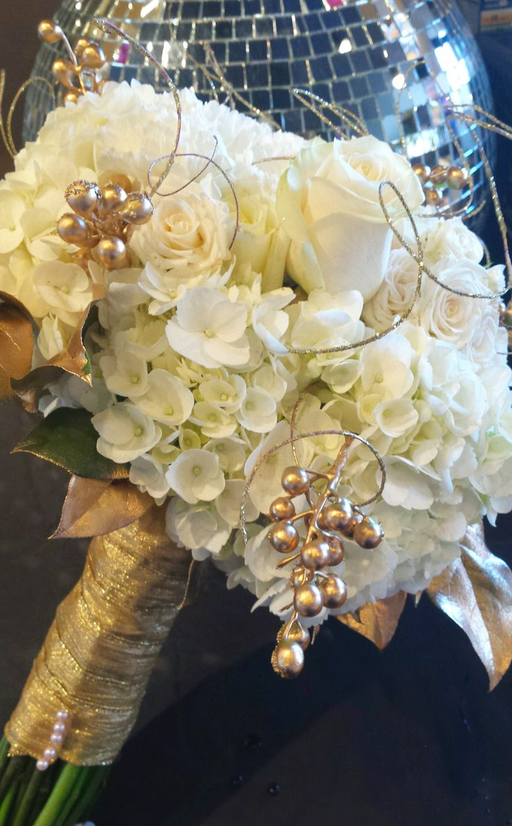 New Years Eve black and gold wedding. Bridal bouquet was all gold and white with white roses, hydrangea, gold painted salal leaves, gold berries, and gold ting.