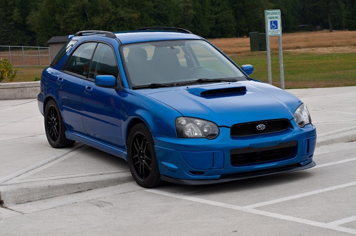 This is an 05 Subaru WRX Wagon. This may be a car I own yet, but not anytime soon. Still rocking the 2.0L Turbo engine these babies have racing seats and cargo room, all on top of a AWD system. When you live where there is snow, these things are king. This one is cool because unlike many subies it has black rather than the gold rims. I love it!