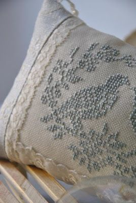 Cross stitch pillow :: Discretely coloured pattern on counted linen...