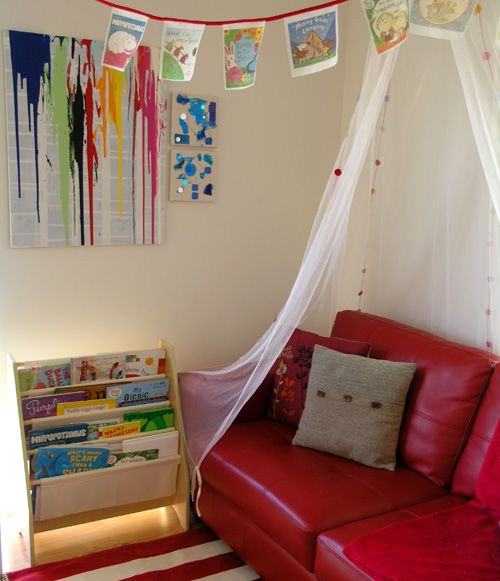 I love this reading space from Christie Burnett at childhood101.com. Check out the awesome book cover bunting up top!