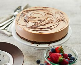 Milk Chocolate Cheesecake with Crunchy Hazelnut Swirl Recipe
