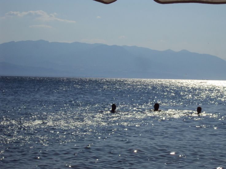 Swimming in the Aegean Sea at Rakis beach with the island of Euboea in the distance.