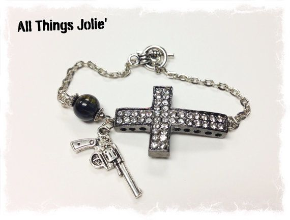 Rhinestone Cross with Silver Gun Charm and a by AllThingsJolie78