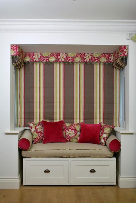 Roman blinds in bay window with box pelmet