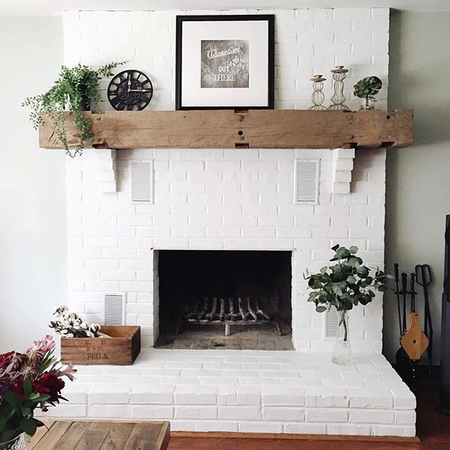 It only took a few years to convince @timbfair to paint our fireplace brick white, haha! Couldn't be more in love with how it turned out and how bright it makes the living room! #fairhavenfarmhouse #fixerupper #allwhiteeverything