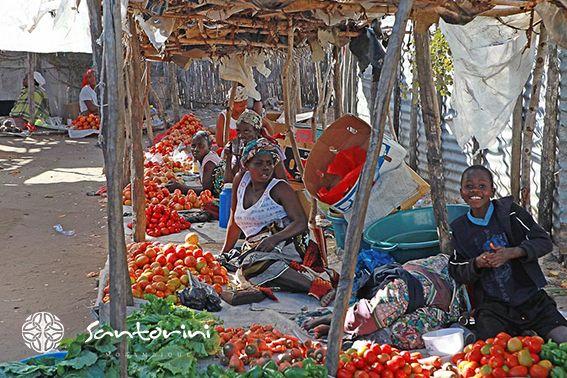 Taking a trip to the local Municipal Market in Vilanculos is as bright and colourful as the locals that occupy it.  #VillaSantorini #Mozambique #Vilanculos #MunicipalMarkey