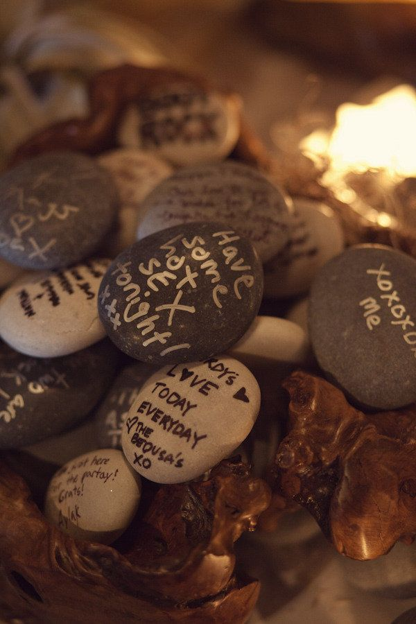 Rocks for people to write well wishes on instead of guest book.. I have already pinned this idea, but just noticed, these people used black AND silver for writting. Shows up better..