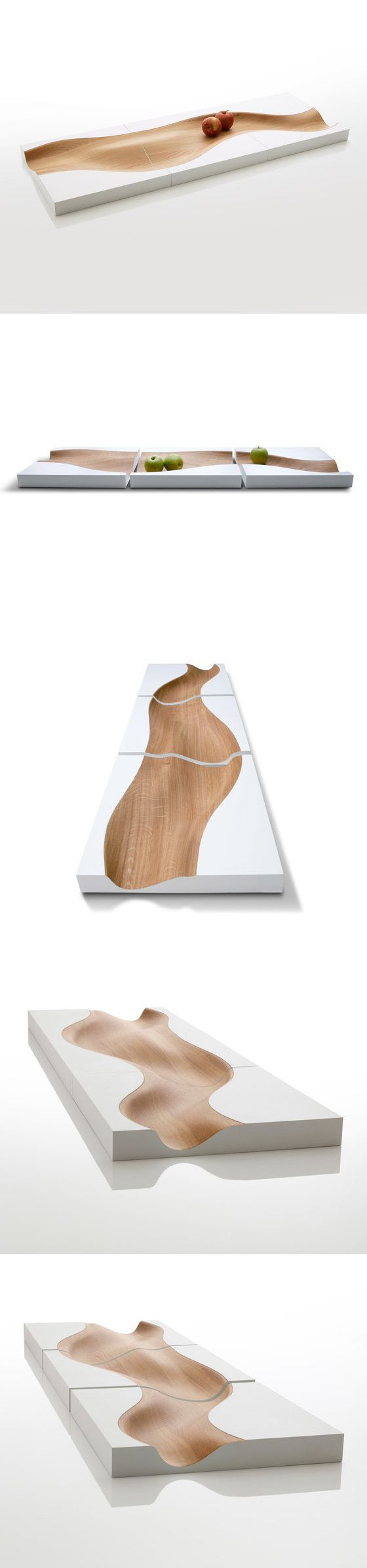 Studio Segers Vloed Tray - The VLOED is an evocative composition of wooden trays shaped like a meandering river through three square sections. This sculptural, sensual and organic design requires both craftsmanship and high technical skills to be produced from a block of solid oak. The natural oiled oak colour represents the river, whereas the riverbanks are contrasting white covers. Available as a set of three trays, or as one separate tray, in oak (natural oiled) with white covered sides.