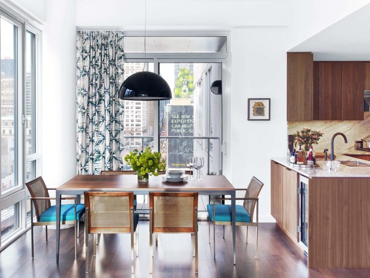 Kitchen with turquoise chairs