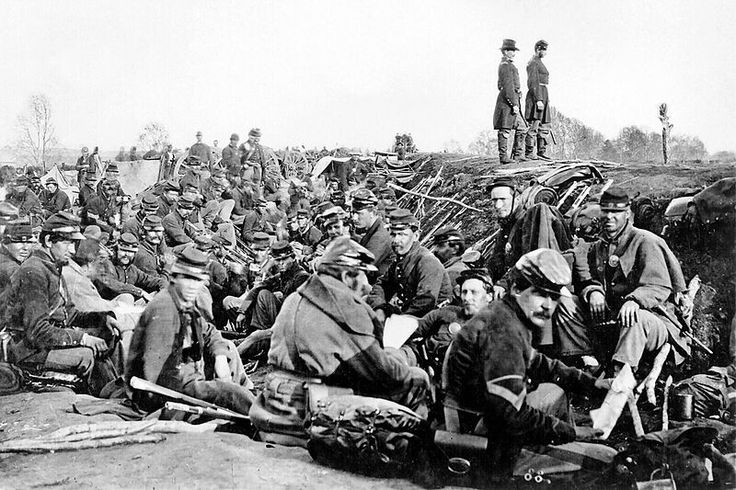 Soldiers of the VI Corps, Army of the Potomac, in trenches before storming Marye's Heights at the Second Battle of Fredericksburg during the Chancellorsville campaign, Virginia, May 1863. [This photograph is sometimes labeled as taken at the 1864 Siege of Petersburg, Virginia