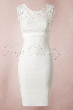 """What a stunner! This isn't just any dress... This50s White Lace Bow Pencil Dressby Unique VIntage is pure elegance and style!You can wear this ivorycoloured beauty to any special occasion and it would even be fabulous to wear it while saying """"I do"""" to your husband-to-be! The sturdy yet stretchy cotton ensures a nice fit and hugs your curves in all the right ways. The dress has a high closed neckline with lace and an elegant, yet sexy low back, oh la la! Finished off with a h..."""