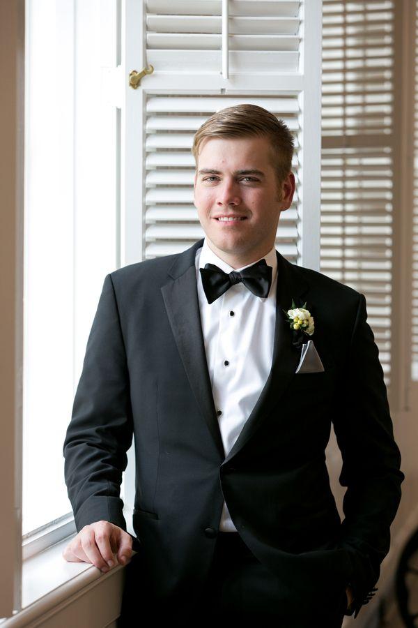 0788f439547ff9 Dapper groom in black and white tux #groom #tuxedo #7centerpieces