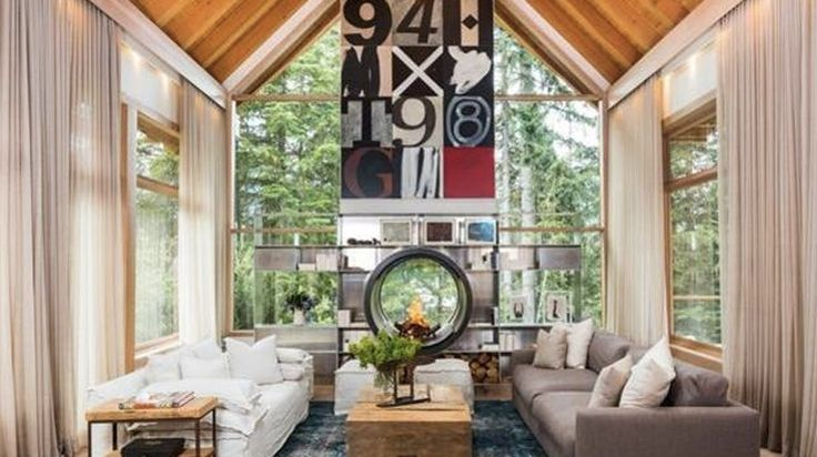 All-glass wall living room with vaulted ceiling