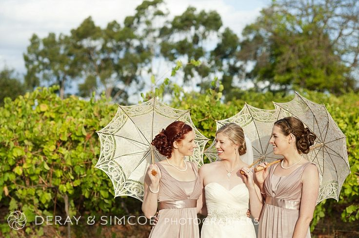 Bride & bridesmaids with soft pink dresses and cream parasols, Swan Valley vineyard, Western Australia Photography by DeRay & Simcoe