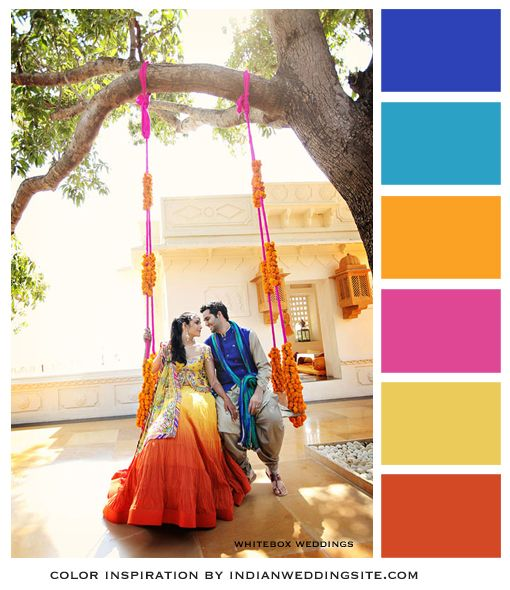 Sunshine yellow, marigold orange, rani pink with royal blue and aqua. Color Inspiration from IndianWeddingSite.com