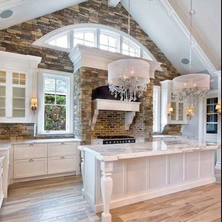 Continued Cathedral Ceiling Into The KitchenShingle Style White Kitchen With Arched Clerestory Windows And Stone Accents