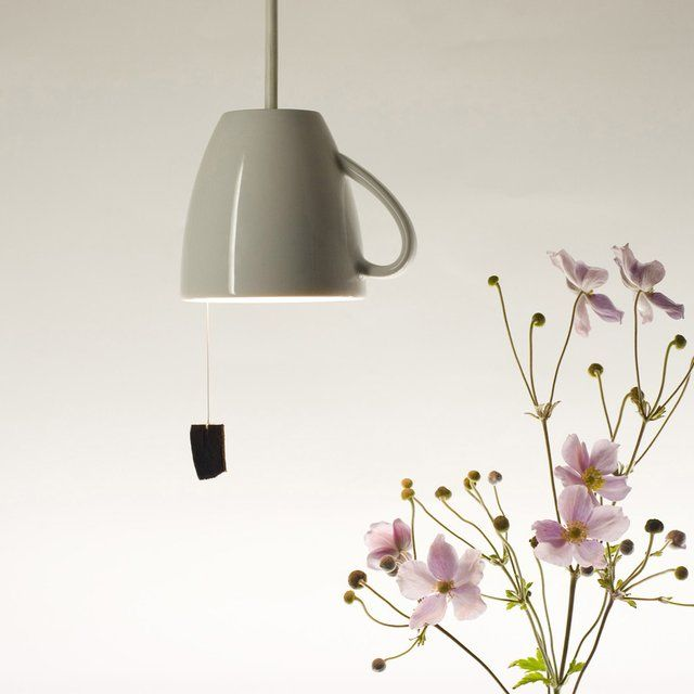 How about a sip of light? This small pendant is made out of a classic cup, with a pretty furry tea bag pull switch completing the idea... China cup from Arzberg in virgin white. E14 metal socket for 25 Watt bulb. Pull switch. Size: 10 x 12 cm, 200 cm cable. Suitable for 230 V, 50 Hz. Please allow 2-3 weeks for shipping.