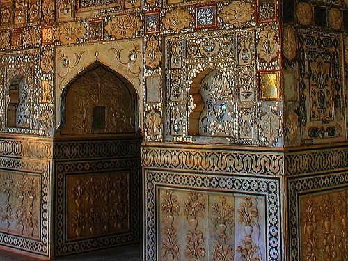 Detail from a wall in Sheesh Mahal (literally, Palace of Mirrors) inside the Amber Fort, near Jaipur in the state of Rajasthan in India.