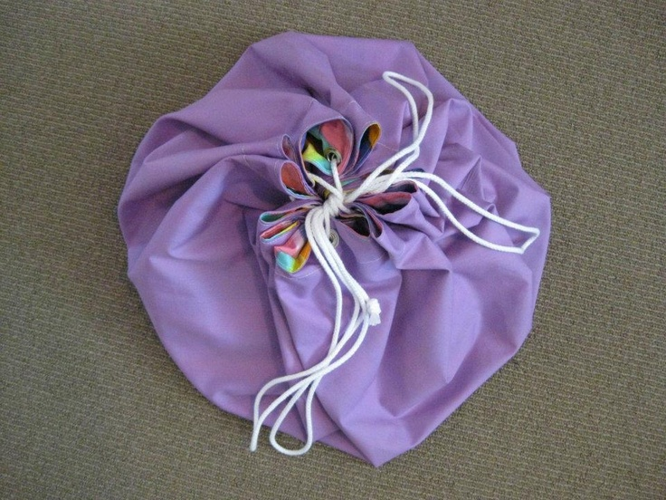 Or tie the drawstring up to stash the toy sack neatly in the cupboard!