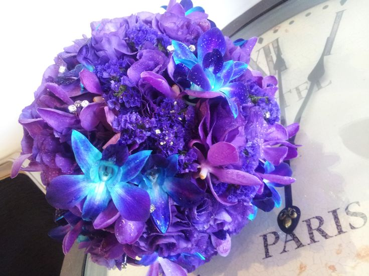 Dreamy posy of Vanda Orchids, Blue Galaxy Orchids, Lissianthus, and Statice. Highlighted with Diamontes. Created by Wedding Flowers & Coffee Cups