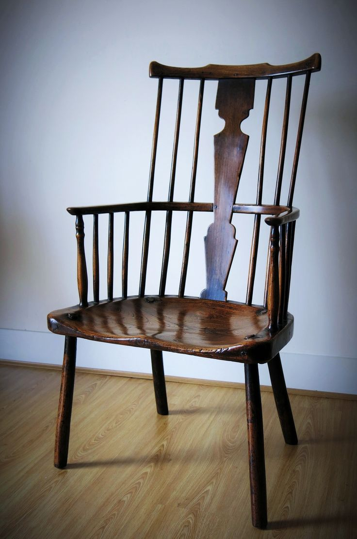 Set of armchairs and rocking chairs just out from beneath the shelter - Early 18th Century Thames Valley Windsor Chair