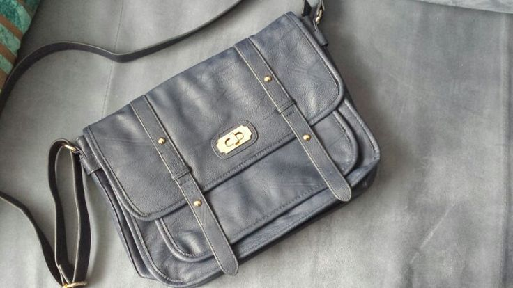 I bought this one in Accessories Store. I love this retro look. It's perfect for casual or any other special occasion. It's medium size. I like bags where I can put all my stuff in. Maybe for some it's too much bc they need few things but I like to be prepared for almost everything so Yes I have....