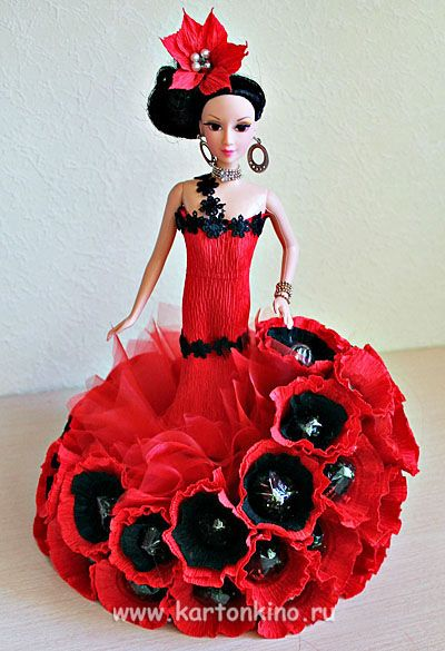 Crepe paper and candy dress this doll for a party