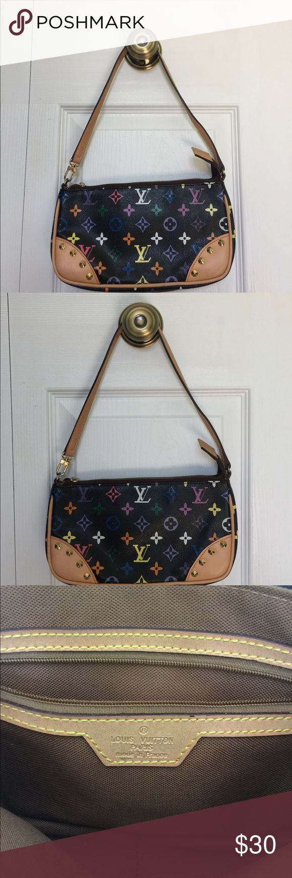 Multicolored Louis Vuitton Small Handbag Gently used. Louis Vuitton handbag. My iPhone 6 Plus with the Otter Defender Case on it does not fit in this purse because the phone cover is too big. Without the phone case on my phone, my phone fits in it perfectly, but I always keep the case on it. I have used this purse a couple a of times. It's in gently used condition. Bags